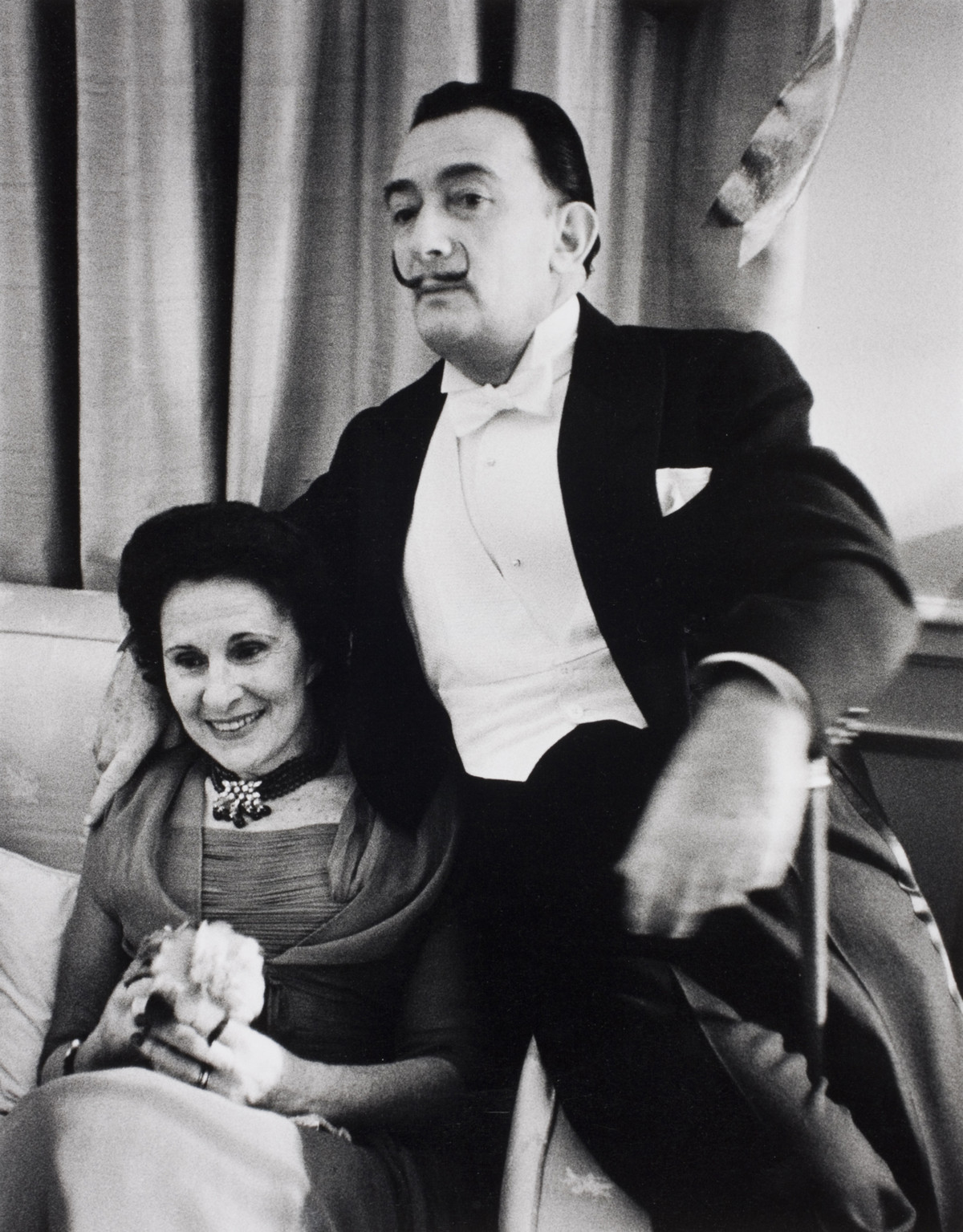 Salvador Dali with his wife at a New Year's party in New York, January 1956.