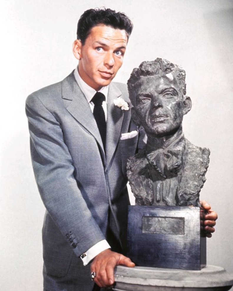 Frank Sinatra and his bust by Jo Davidson