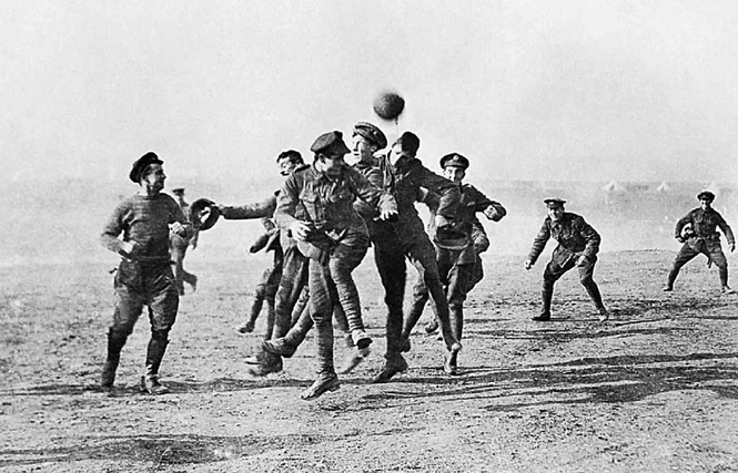 Soldiers playing football during WWI Christmas truce in 1914
