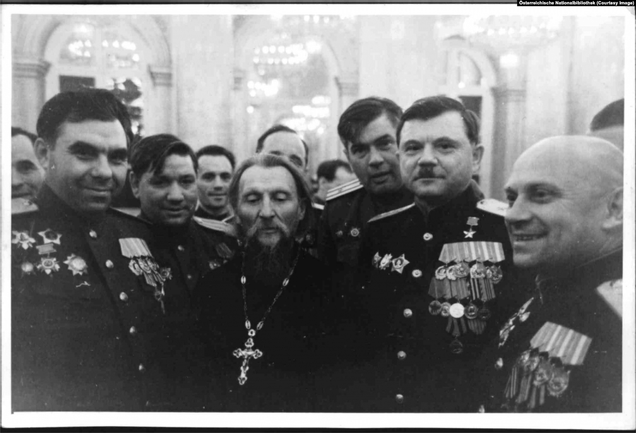 Soviet officers with the local ortodox priest