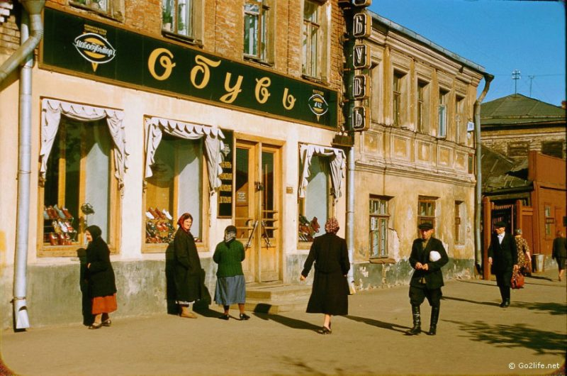 Soviet people passing by a store