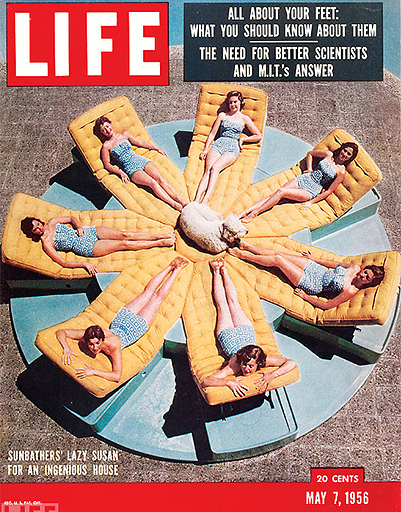 Sunbathing girls in bikinis on the cover of LIFE 1956.