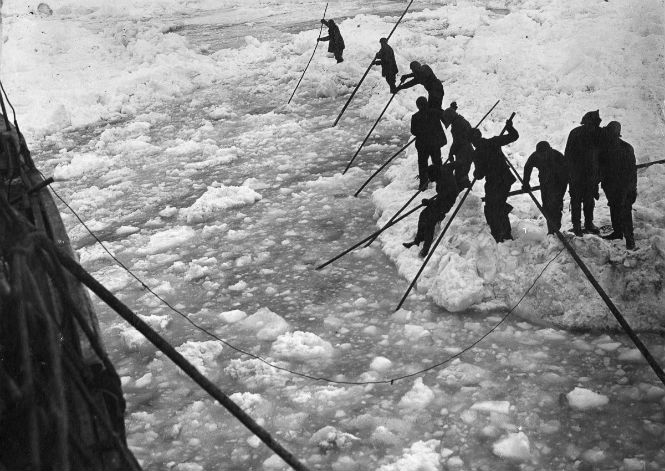 The ship's crew clears the ice from the Endurance.