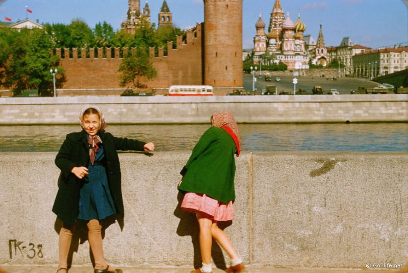 Two soviet girls standing at the Moscow river enbankment, 1950s