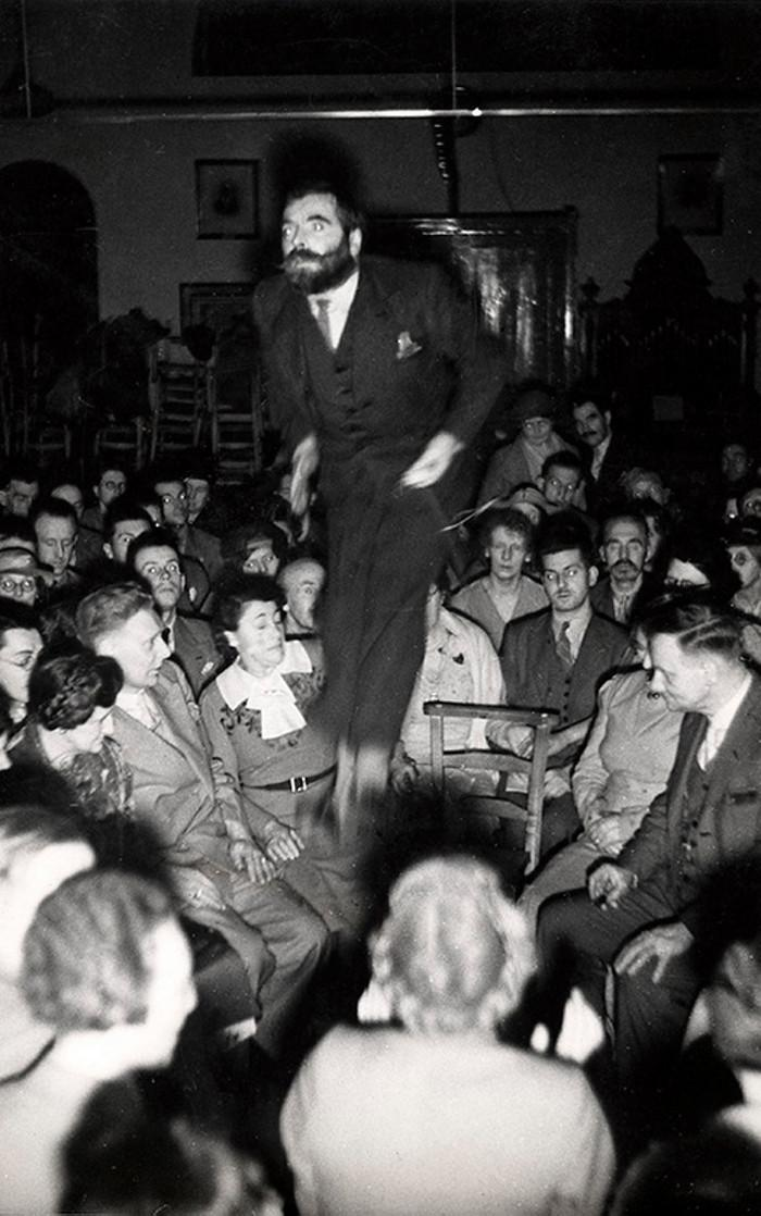 Welsh spiritualist Colin Evans feigns levitation by jumping up and down in total darkness and filming himself with an infrared camera. London, 1939