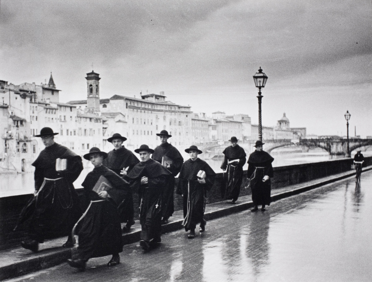 Young monks walk across the Ponte Vecchio in Florence, Italy, 1935.