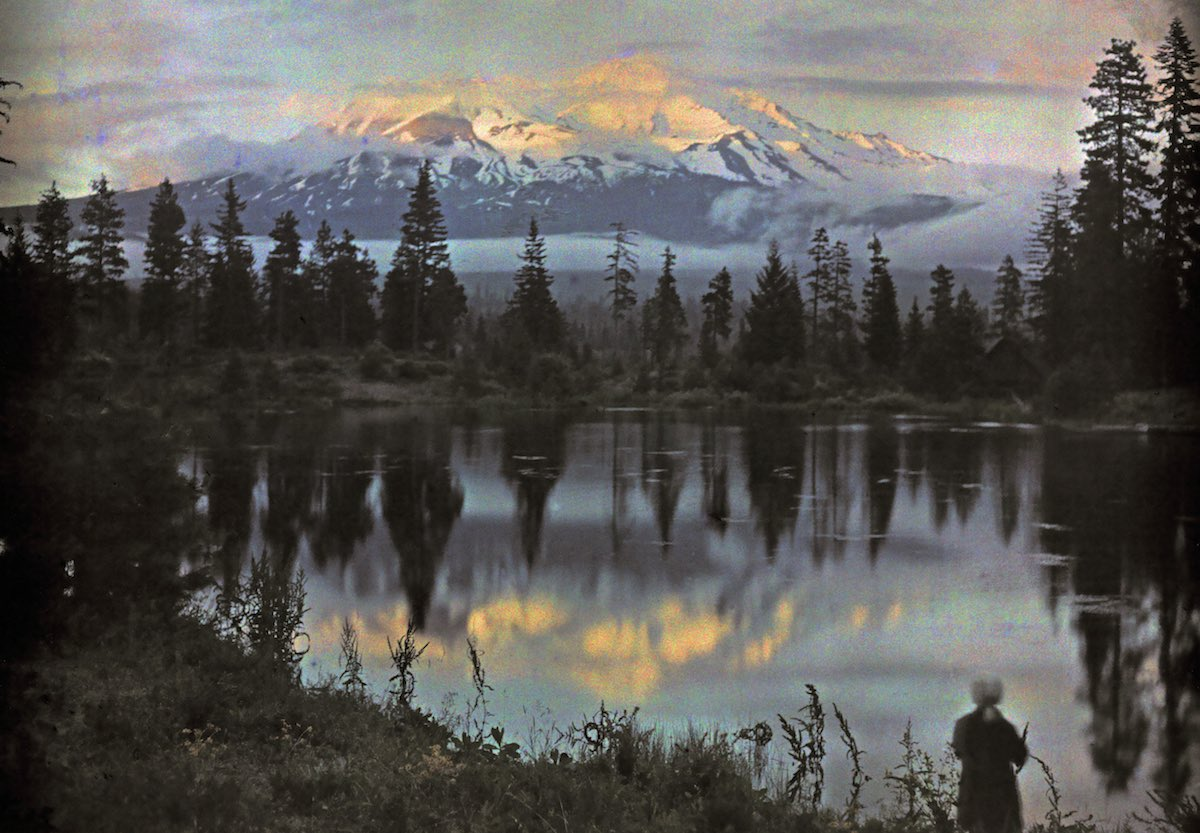 Mount Shasta in California and a woman at the edge of a pond. Photo by Franklin Price Knott