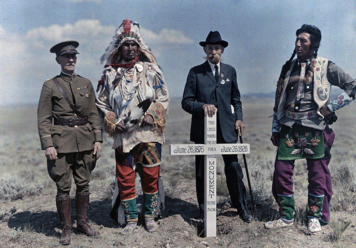 Crowe Indian Reservation, Montana - Men stand next to the monument to the Seventh Cavalry.