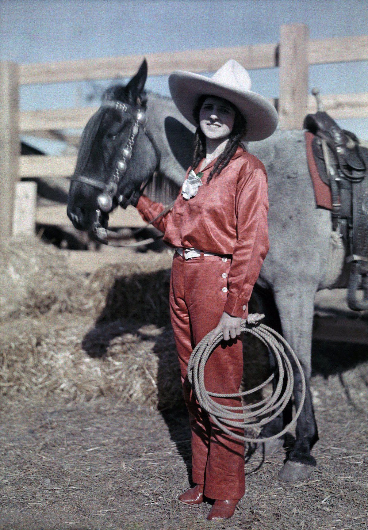 A rider poses with her pony in a rodeo in Texas. Photo by  Clifton R. Adams