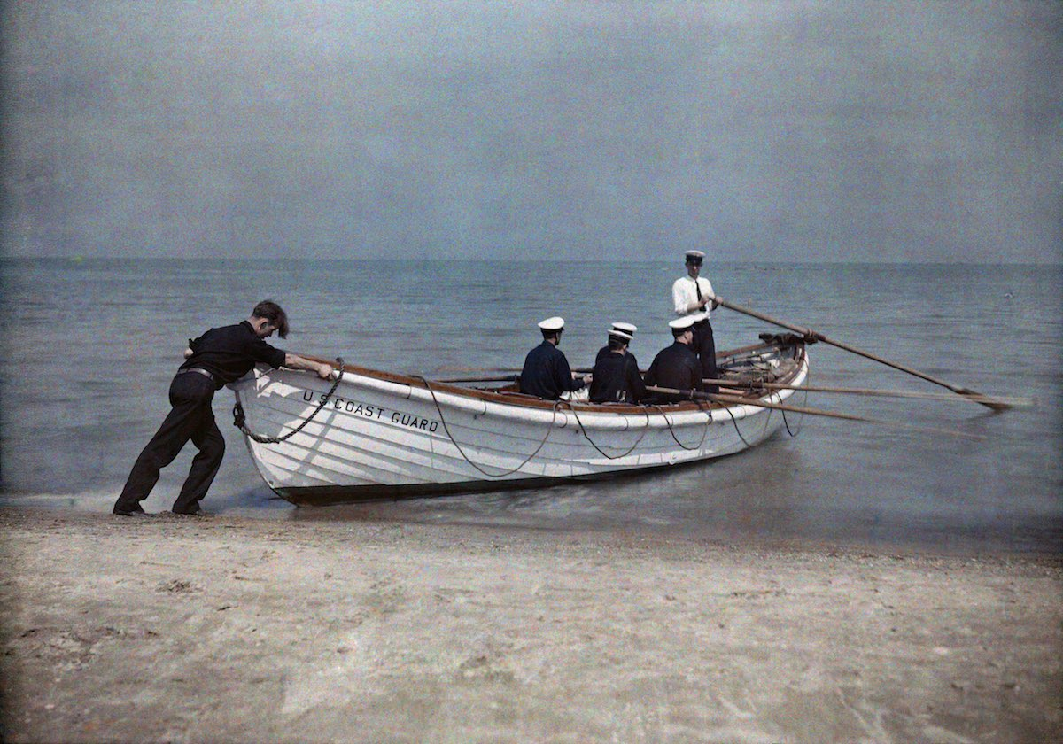 Coast Guard officers set sail in their boat.