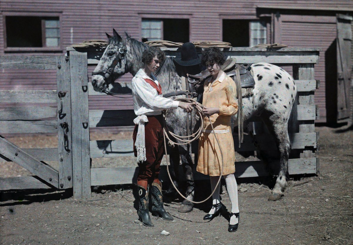 A rider shows her sister how to handle ropes, Fort Worth, Texas.