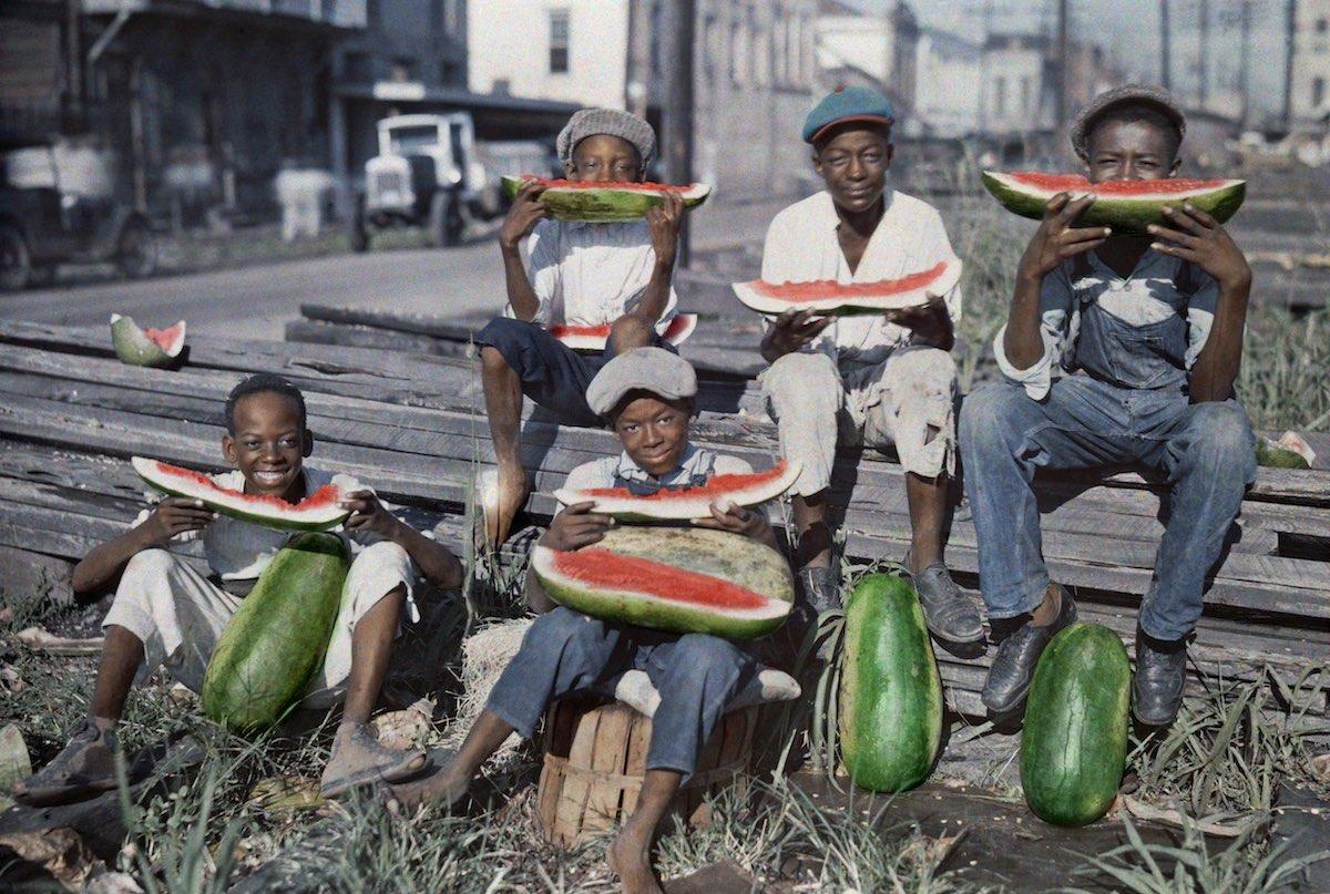 Five boys eat a watermelon in New Orlean. Photo by Edwin L. Visherd