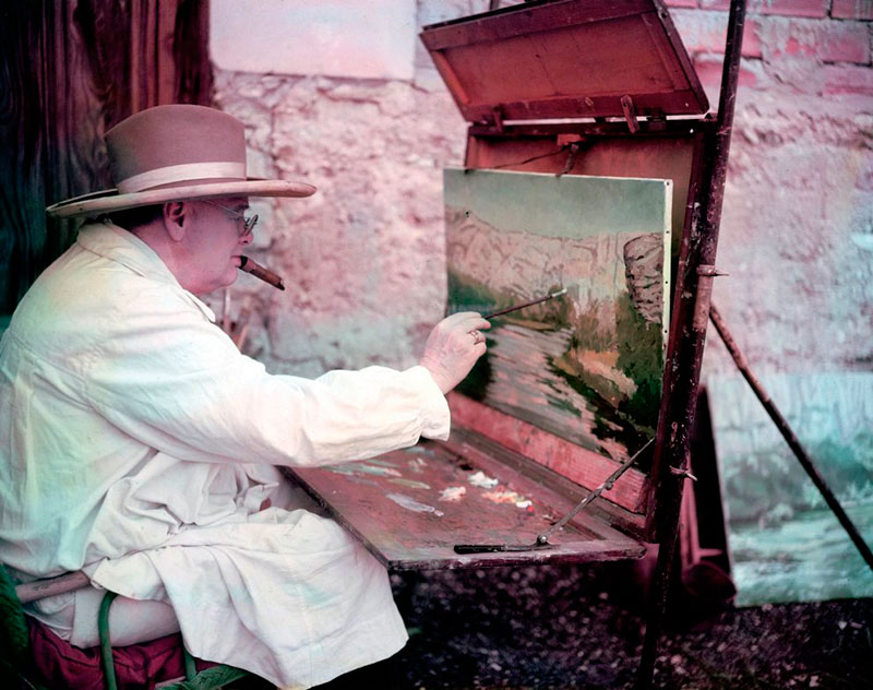 Winston Churchill was a modest artist. He called his paintings daub. In this photo, he's drawing in his studio in Kent.