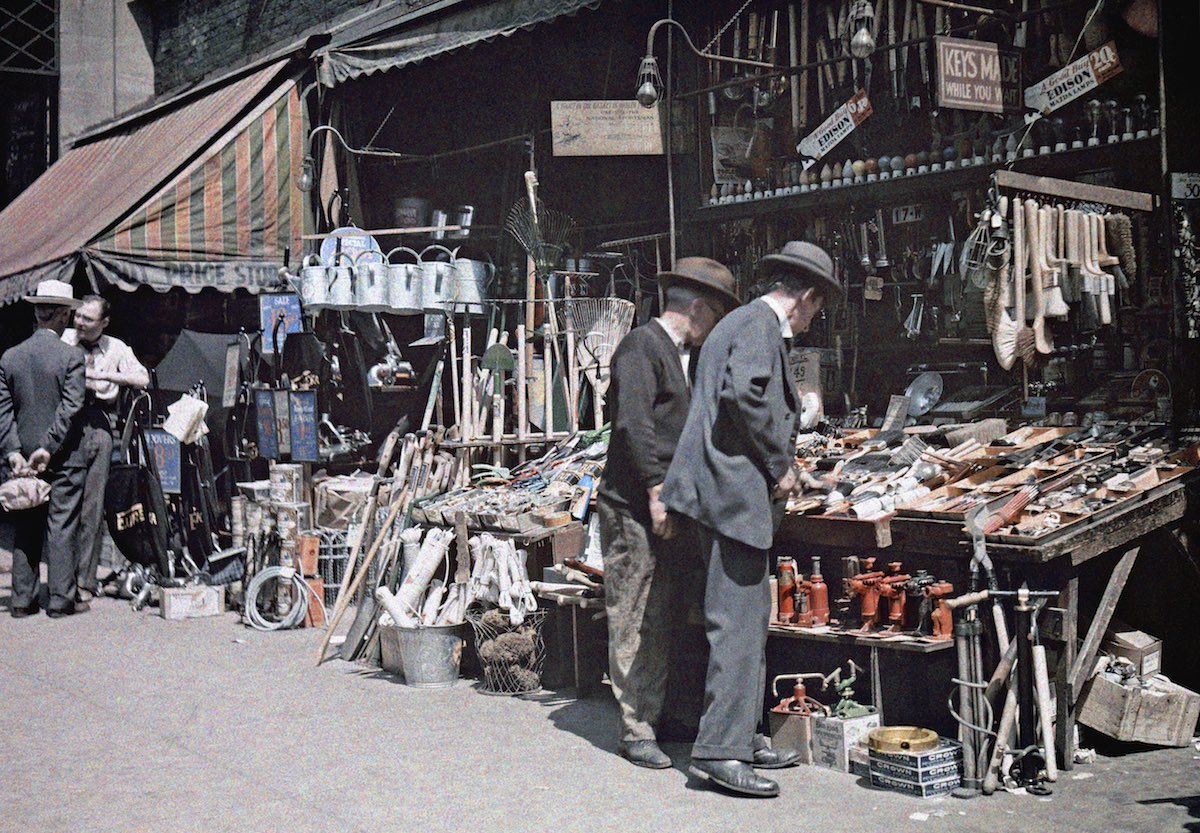 New Yorkers browse the assortment of goods sold along city streets. Photo by Clifton R. Adams and Edwin L. Visherd.