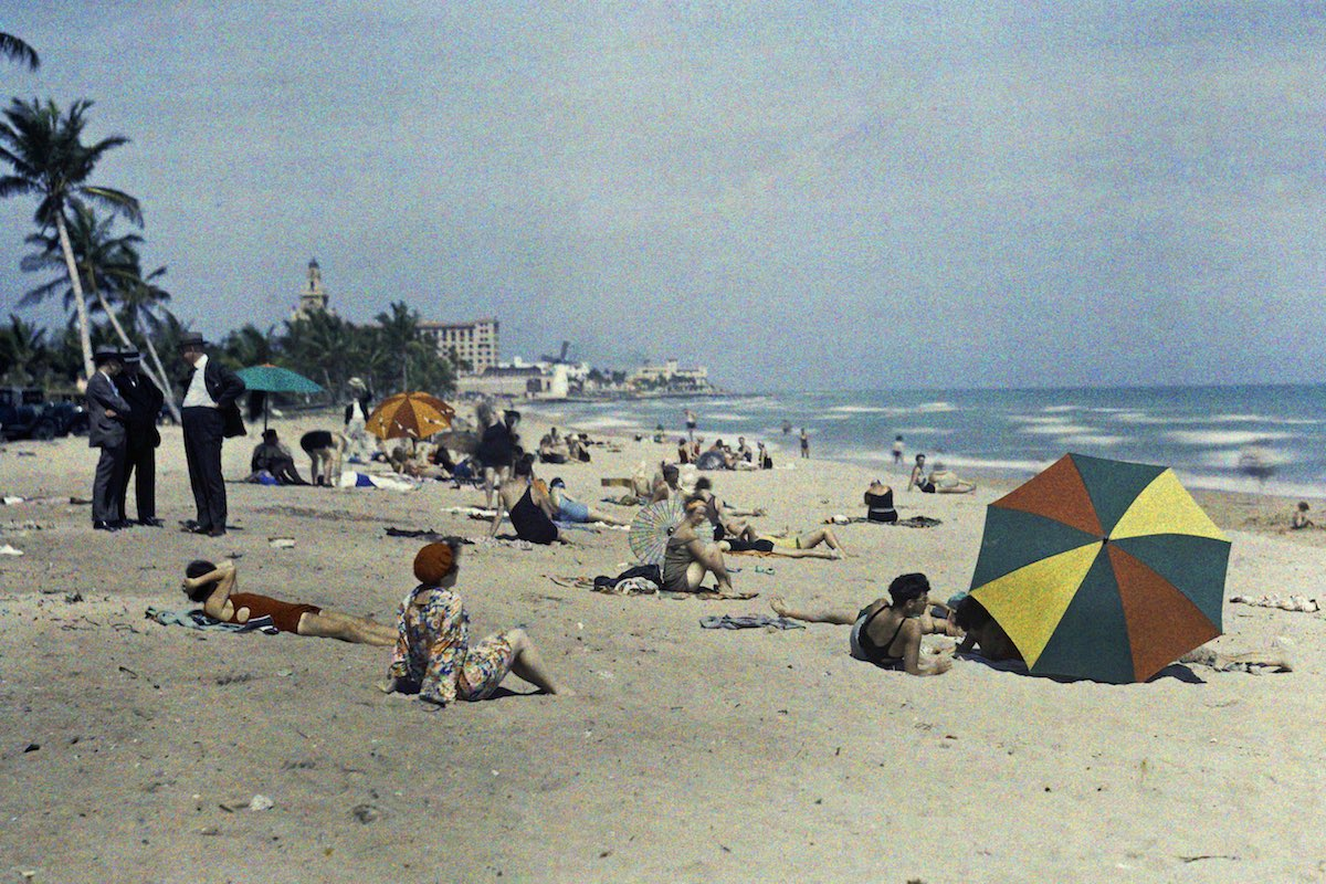 A group of people relaxing on the ocean coast, Miami Beach, Florida