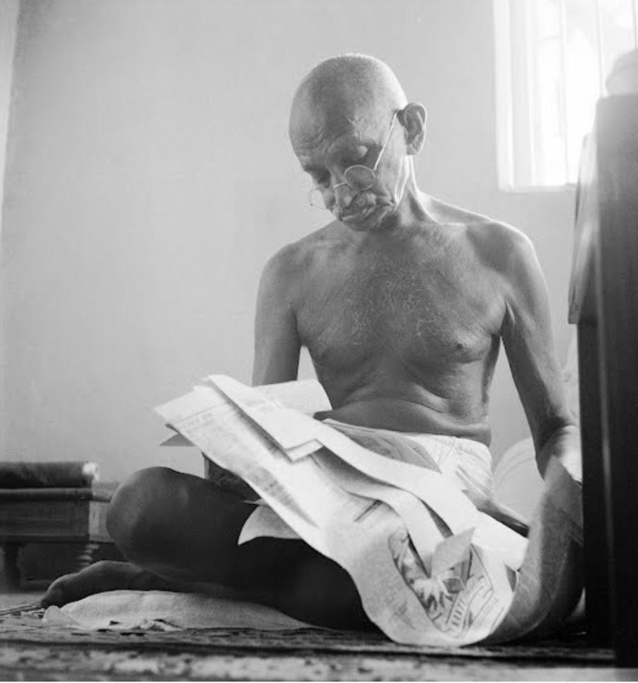 Gandhi reading religious texts