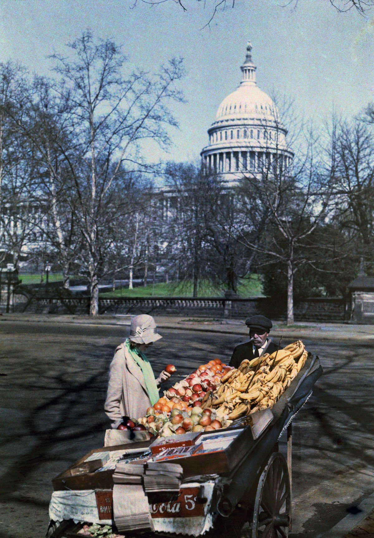 woman in front of a fruit rack in the US capital.