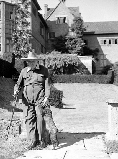 Winston Churchill and his poodle Rufus. Chartwell estate in Kent, 1947.